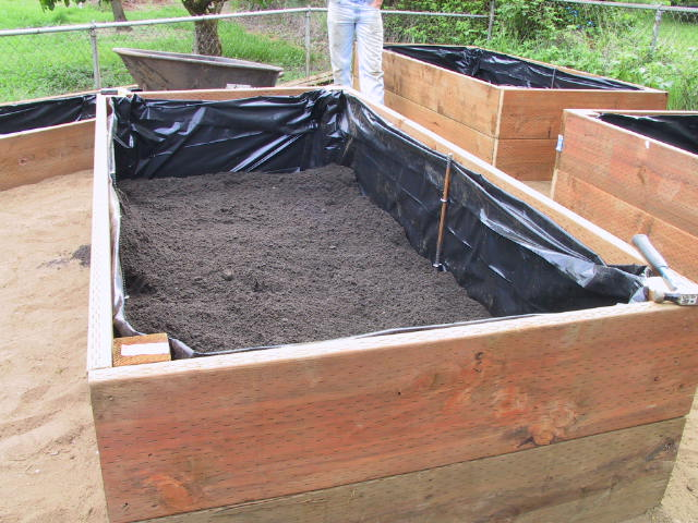 Half full of topsoil and compost